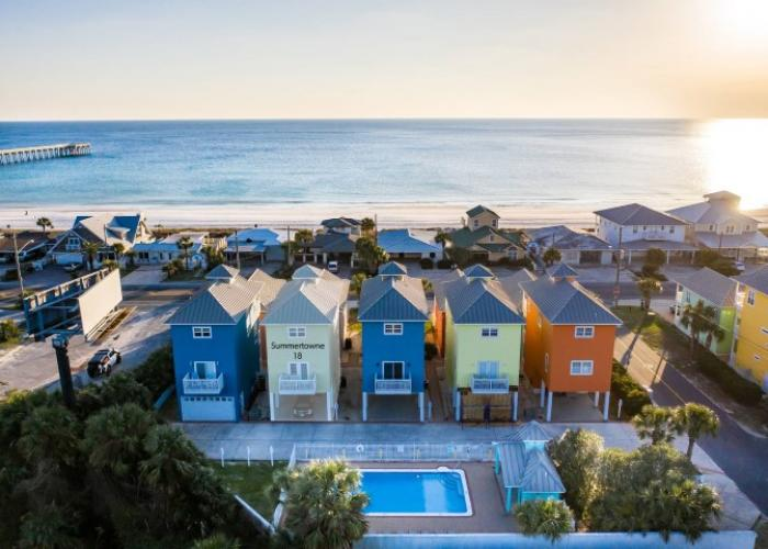 Colorful townhomes overlooking the gulf during a sunset