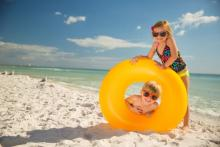 Kids playing at beach with inner tube